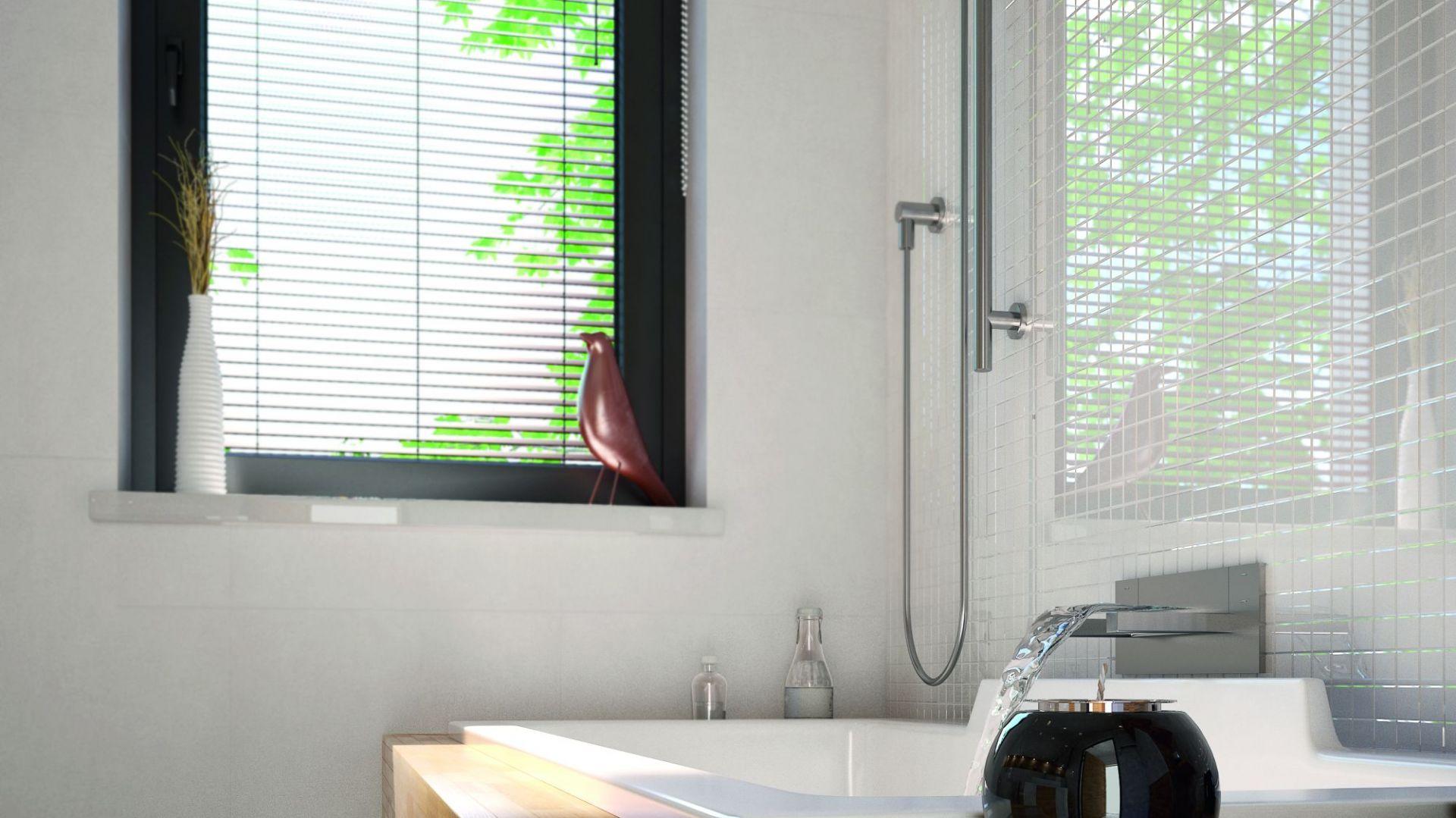 Niewielki okno zapewnia dopływ światła dziennego. Dom Umbra. Projekt: arch. Maciej Matłowski. Fot. Domy w Stylu