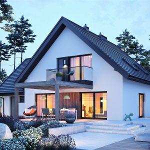 Dom w scenerii nocnej. Dom Mini 8 w. II G1. Projekt: arch. Artur Wójciak. Fot. Pracownia Projektowa Archipelag
