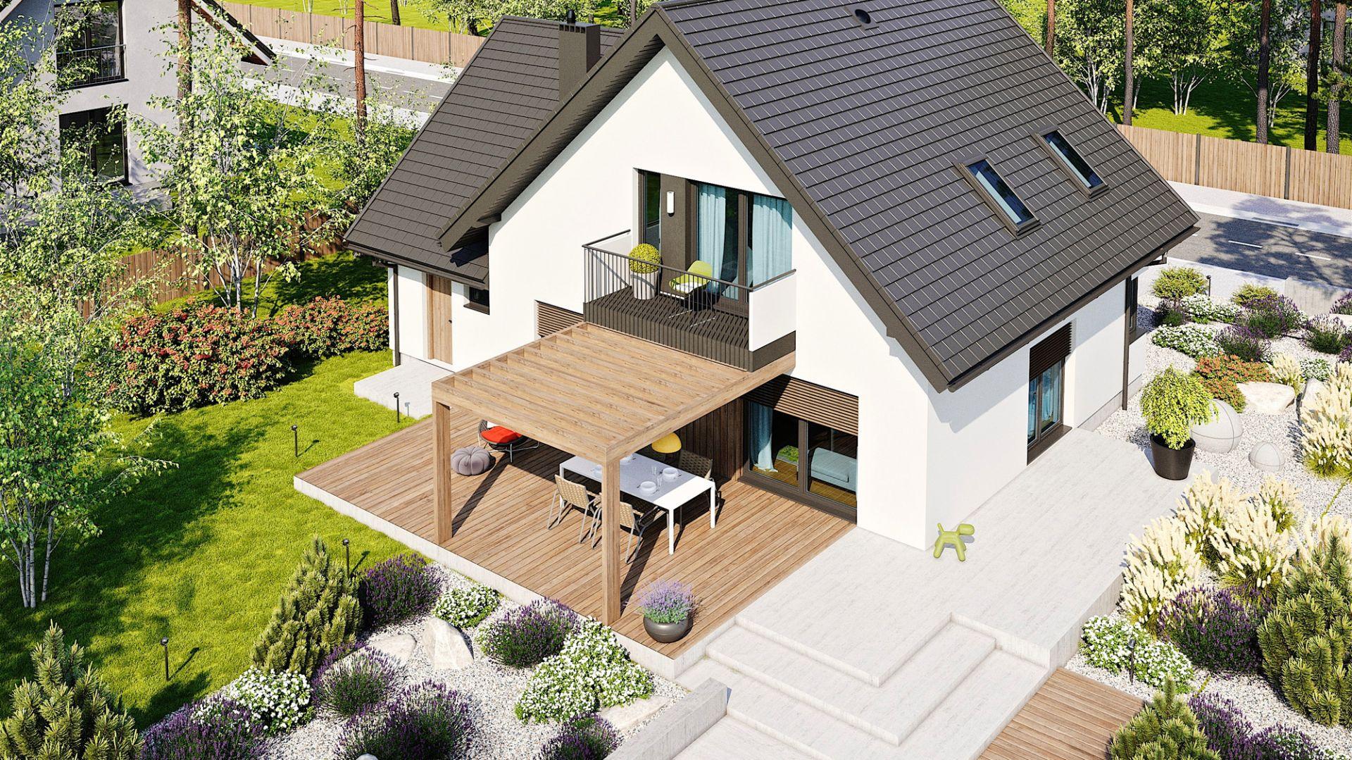 Dużym plusem projektu jest okazały taras z dekoracyjną pergolą tworzącą spójną kompozycję z balkonem. Dom Mini 8 w. II G1. Projekt: arch. Artur Wójciak. Fot. Pracownia Projektowa Archipelag