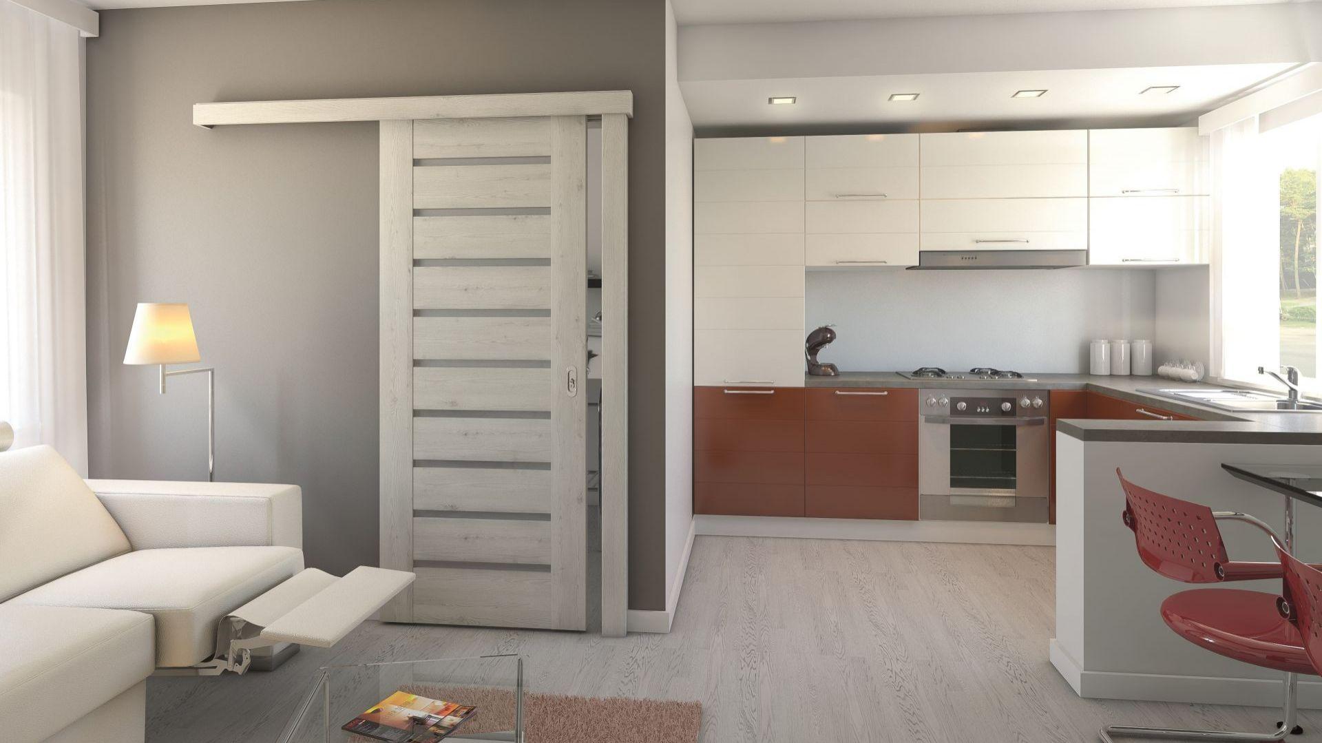 Dobrym sposobem na zaoszczędzenie przestrzeni w małym mieszkaniu jest zastosowanie drzwi w wersji przesuwnej. Wówczas powierzchnię, którą zajmują tradycyjnie Fot. Porta Drzwi