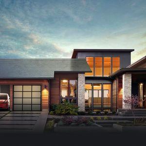 Firma Tesla wprowadziła na rynek produkt, który w pełni integruje panele fotowoltaiczne z dachem. Nie trzeba montować oddzielnie paneli fotowoltaicznych na dachu. Ich rolę przejęły dachówki fotowoltaiczne. Fot. Tesla