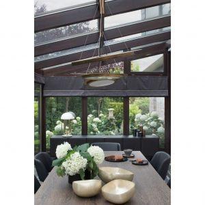 Wnętrza zaprojektowane przez Annę Koszelę realizują pragnienie właścicieli o komfortowej przestrzeni, która będzie wchodziła w dialog z otaczającym ją ogrodem. Projekt i zdjęcie: Anna Koszela