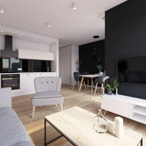 Projekt niewielkiego (35 m kw.), nowoczesnego mieszkania w Poznaniu oparto na trzech podstawowych założeniach: miało być funkcjonalnie, nowocześnie i uniwersalnie. Projekt i wizualizacja: Natalia Robaszkiewicz (Boske Art Projektowanie Wnętrz)