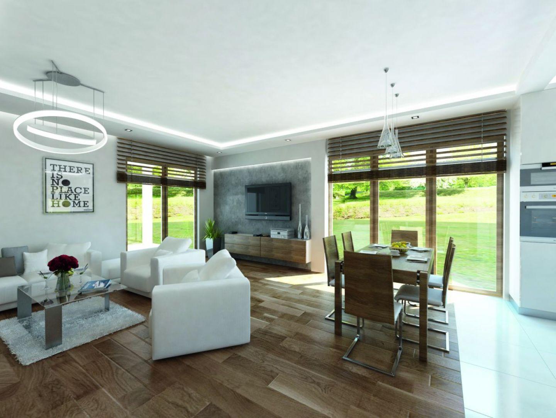 Wnętrze domu zaprojektowano nowocześnie. Centralnym miejscem jest otwarta strefa dzienna łącząca salon, jadalnie i kuchnię. Fot. Biuro Projektów MTM Styl