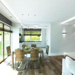 Biała zabudowa w kuchni doskonale koresponduje z resztą wnętrza. Fot. Biuro Projektów MTM Styl