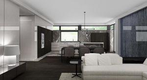 Nowoczesny dom urzeka konsekwentną kolorystyką.Brązy, czernie i szarości tu i ówdzie przełamano subtelnymi, jasnymi barwami i materiałami o ciekawych fakturach. W ten sposób pracownia architektoniczna Wyrzykowski Studio zniwelowała wrażenie ci