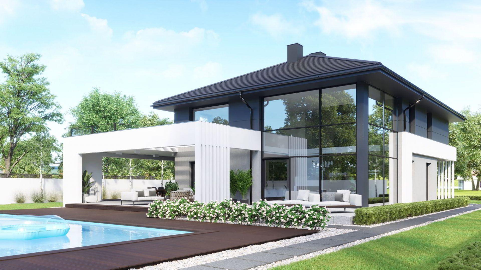 Z zewnątrz dom przyciąga uwagę doskonale zaaranżowaną, ponadczasową elewacją.Dom HomeKONCEPT 60. Opracowanie projektu i zdjęcia: Pracownia HomeKONCEPT