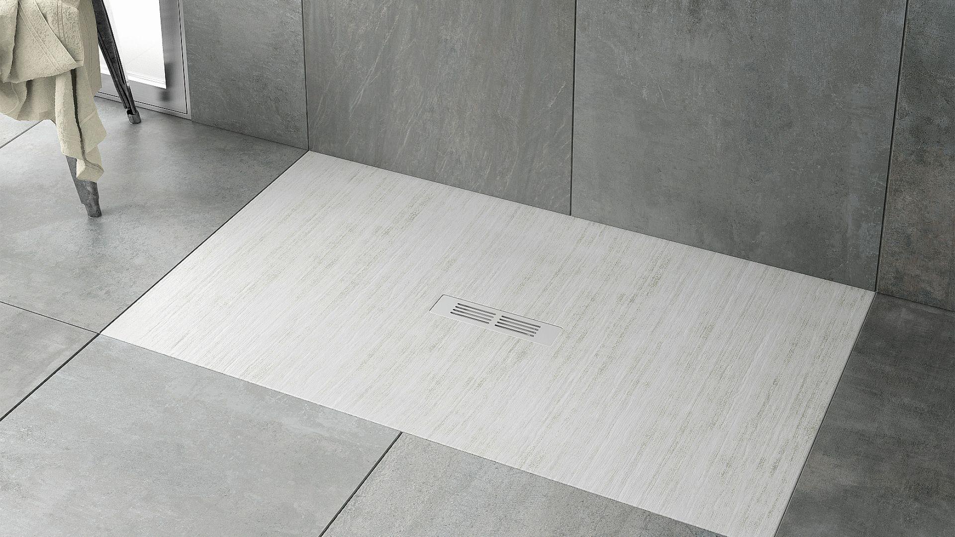 Ultrapłaski brodzik prostokątny Helios z wytrzymałego kompozytu Stonex. Ze zintegrowanym dnem antypoślizgowym. Odpływ w zestawie. Fot. Roca