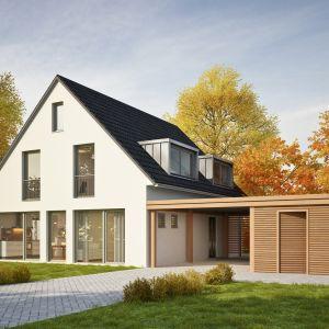 Wiata garażowa przynosi wiele praktycznych korzyści. Stanowi bardzo przydatną alternatywę dla klasycznego garażu, jako dodatkowe miejsce postojowe. Nie wymaga pozwolenia na budowę, jeśli standardowa powierzchnia konstrukcji wiaty nie przekracza 50 m2. Fot. Drewnochron