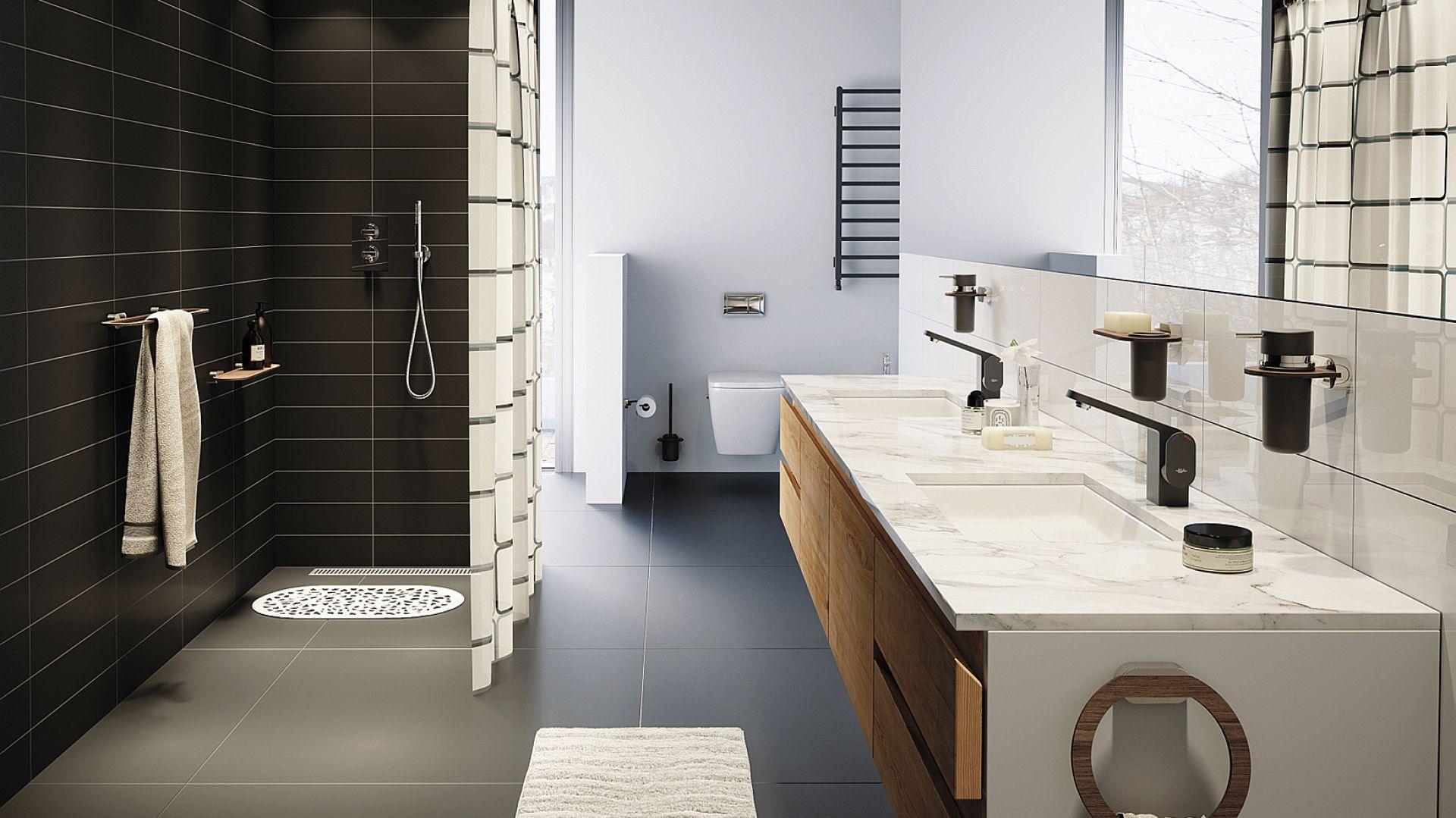 Kolekcja akcesoriów łazienkowych Bergen, będąca eleganckim połączeniem tradycyjnych metalowych rozet z odpornym na zarysowania i korozję nowoczesnym, wodoodpornym materiałem (HPL) umożliwiającym uzyskanie faktury drewna. Cena: 119 zł/wieszak kąpielowy. Fot. Bisk