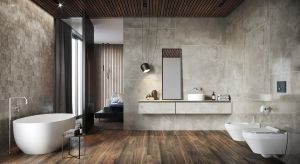 Urządzanie łazienki zacznij od podłóg i ścian. Najpopularniejsze materiały okładzinowe to niezmiennie płytki ceramiczne i gresowe, a najmodniejsze kolekcje mają wzór kamienia naturalnego, drewna albo betonu.