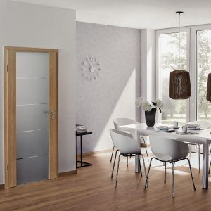 Drzwi drewniane z serii DesignLine. Dostępne w różnych wariantach wykonania oraz z ciekawymi elementami m.in. aplikacje ze stali nierdzewnej, pogłębione szczeliny, finezyjne. Dostępne w ofercie firmy Hörmann. Fot. Hörmann
