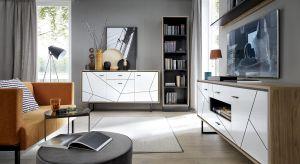 Cechą charakterystyczną kolekcji są czarne frezowania na frontach mebli, które tworzą niezwykle modny w tym sezonie geometryczny zabieg dekoracyjny.