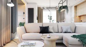 Wysmakowane i eleganckie, a przy tym niepozbawione domowego ciepła i przytulności mieszkanie urządzono czerpiąc inspiracje z różnych stylów. Bazę aranżacji stanowi minimalizm, który projektantka wzbogaciła o elementy industrialne oraz skandynaw