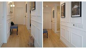 Do części dziennej prowadzi hol, w którym zdecydowano się położyć na ścianach białe panele nawiązujące do dawnych boazerii. Projekt: Barbara Godawska (ihome Studio). Fot. Dekorian