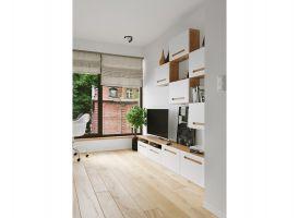 Mikropartamenty mieszczą niewielki aneks kuchenny, szafę, łóżko, biurko i małą łazienkę, a także dwuosobową sofę z funkcją spania. Projekt: The Space