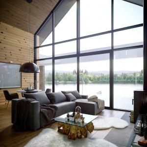 Salon łączy się z pięknym tarasem wypoczynkowym, który w czasie ciepłych dni będzie najchętniej wykorzystywanym miejscem wypoczynku w całym domu. Dom HomeKONCEPT 66. Projekt i zdjęcia: HomeKONCEPT