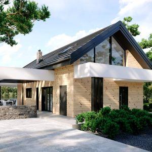 Drewno i kamień doskonale ożywiają minimalistyczną bryłę domu. Dom HomeKONCEPT 66. Projekt i zdjęcia: HomeKONCEPT