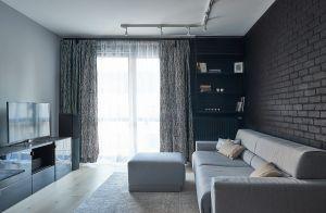 Męski azyl: małe mieszkanie w szarościach. Projekt: SOLI Architekci