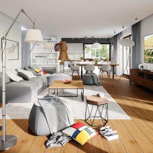 Salon w bieli i szarościach pięknie prezentuje się w towarzystwie naturalnego drewna, które wnosi do wnętrza ciepło i spokój. Dom Alison IV G2 Energo Plus. Projekt: arch. Artur Wójciak. Fot. Pracownia Projektowa Archipelag