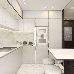 Posadzkę, blaty i okładziny ścienne w kuchni zostały wykonane z marmuru Statuario.  Projekt i zdjęcia: pracownia architektoniczna Wyrzykowski Studio
