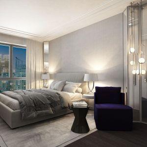 Na ścianach sypialni dominuje jasnoszara kolorystyka. Projekt i zdjęcia: pracownia architektoniczna Wyrzykowski Studio