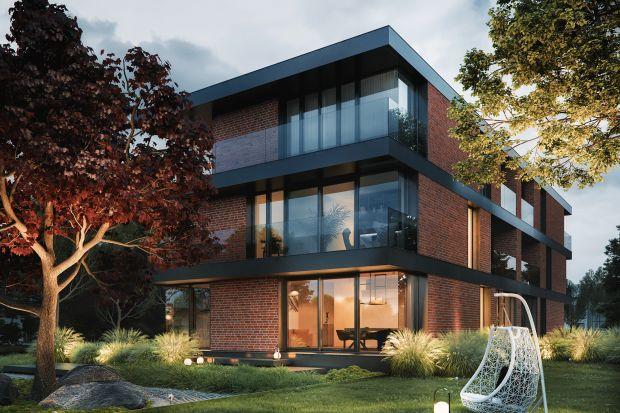 Cegła i szkło na elewacji: zobacz nowoczesny, piętrowy dom