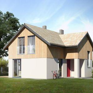 Bardzo prosta konstrukcja z dwuspadowym dachem, skromne wykończenie elewacji i niewielka powierzchnia sprawią, że inwestycja nie będzie skomplikowana i kosztowna. Dom Mini 1. Projekt: arch. Sylwia Strzelecka. Fot. Projekty Sylwii Strzeleckiej