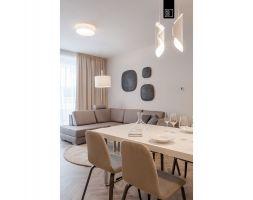 Mieszkanie utrzymane jest w różnych odcieniach beżu, kawy z mlekiem, bieli i czerni. Projekt i zdjęcia: Pracownia Wnętrz KODO