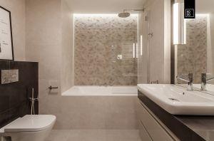 W łazience niezłe wrażenie robi podświetlona struktura za wanną. Projekt i zdjęcia: Pracownia Wnętrz KODO