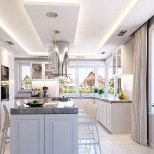 Kuchnia połączona z jadalnia i salonem jest zaprojektowana bardzo nowocześnie. Dom Willa Parkowa 6. Projekt: arch. Michał Gąsiorowski. Fot. MG Projekt