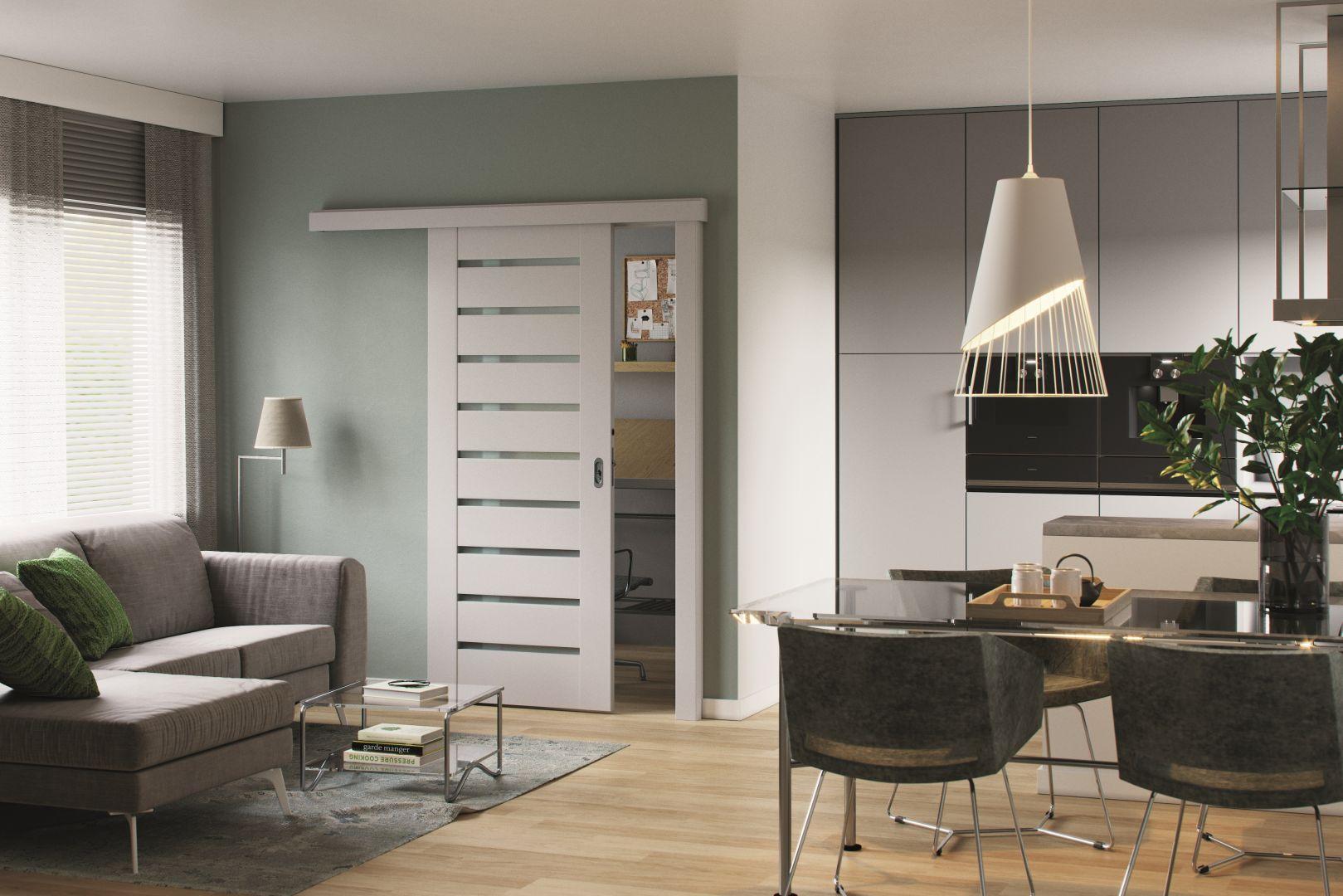 Drzwi w wersji przesuwnej kolekcji Porta Koncept niezastąpione w małych mieszkaniach. Fot. Porta