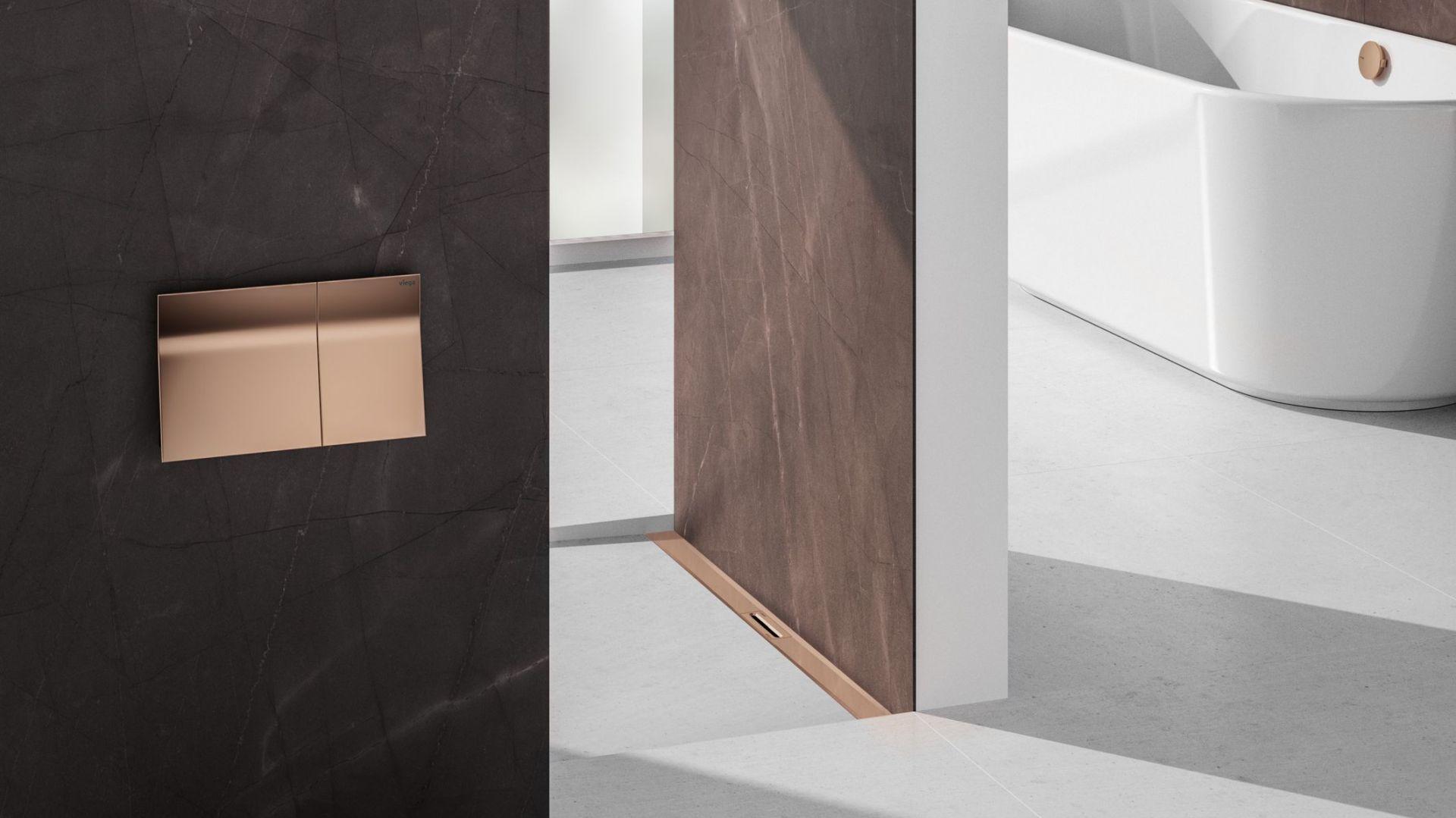 Przycisk uruchamiający do WC, odpływ prysznicowy i element kompletu odpływowego do wanny w modnym kolorze miedzi. Fot. Viega