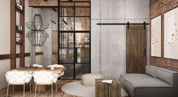 Loftowe wnętrze z charakterem - postaw na cegłę, beton i drewno!
