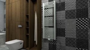 Obszerna zabudowa w strefie toalety pomieści niezbędne kosmetyki, zapasowe ręczniki i inne akcesoria. Projekt i wizualizacje: mia architekci