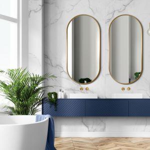 Lustro owalne Ambient Slim Gold dzięki bardzo wąskiej ramie jest niezwykle dekoracyjne. Fot. Giera Design