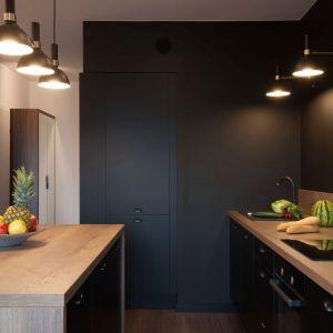 Elementem oddzielającym optycznie część kuchenną od dziennej jest oryginalna wyspa. Projekt i zdjęcia: KODO