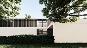 Architekci zastosowali paletę bieli, drewna i odcieni szarości. Projekt: modula architekci