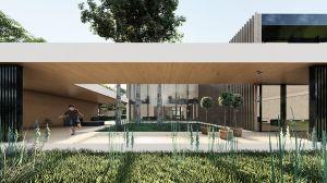 Biała architektura budynku poprzez kontrast podkreśla zieleń, zarówno zaprojektowaną, jak i istniejącą już na terenie. Projekt: modula architekci