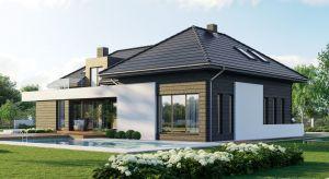Dom przyciąga uwagę przede wszystkim niepowtarzalną bryłą, ciekawymi detalami architektonicznymi oraz niezwykle efektowną elewacją.Wnętrze zaprojektowano z myślą o komforcie 4-osobowej rodziny.