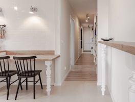 Chłód bieli ocieplono za pomocą naturalnych materiałów oraz stylowych akcentów, stosując je konsekwentnie we wszystkich pomieszczeniach mieszkania. Projekt i zdjęcia: KODO