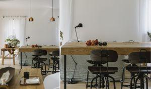 """W apartamencie zastosowano także """"fabryczne"""" elementy. Należą do nich czarne stalowe krzesła, żeliwny grzejnik i industrialne oświetlenie. Projekt i zdjęcia: STUDIO.O. organic design"""