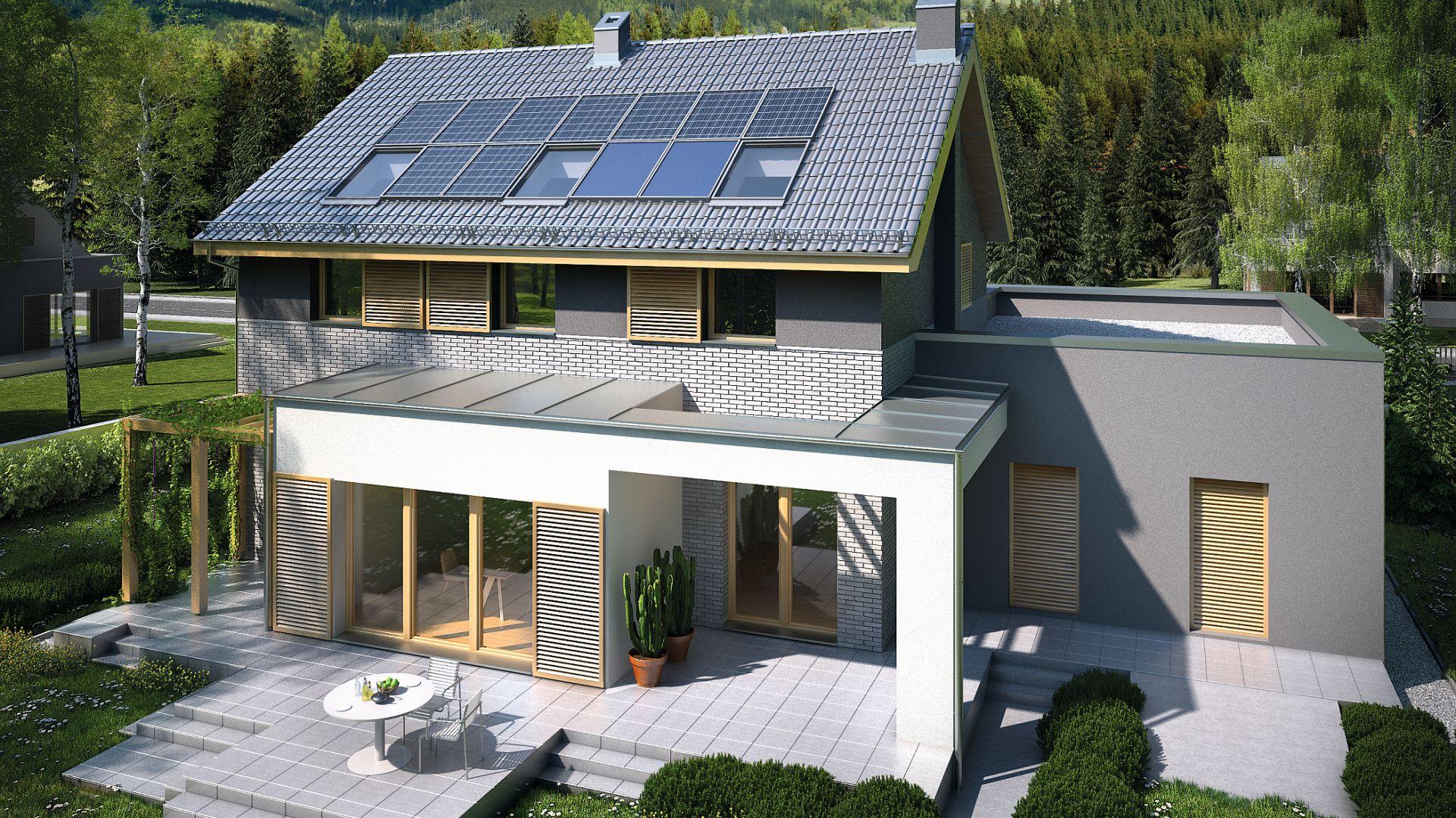 Kolektory słoneczne służą do podgrzewania ciepłej wody użytkowej. Dodatkowo mogą być wykorzystywane jako wspomaganie wodnego ogrzewania budynku. Projekt: Sielski. Fot. Domy Czystej Energii