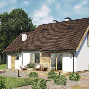 Budynek z piętrem lub poddaszem użytkowym korzystny jest na działkach niewielkich, ponieważ pozwala na wygospodarowanie większego ogrodu. Projekt: D289. Fot. Artinex Projekt