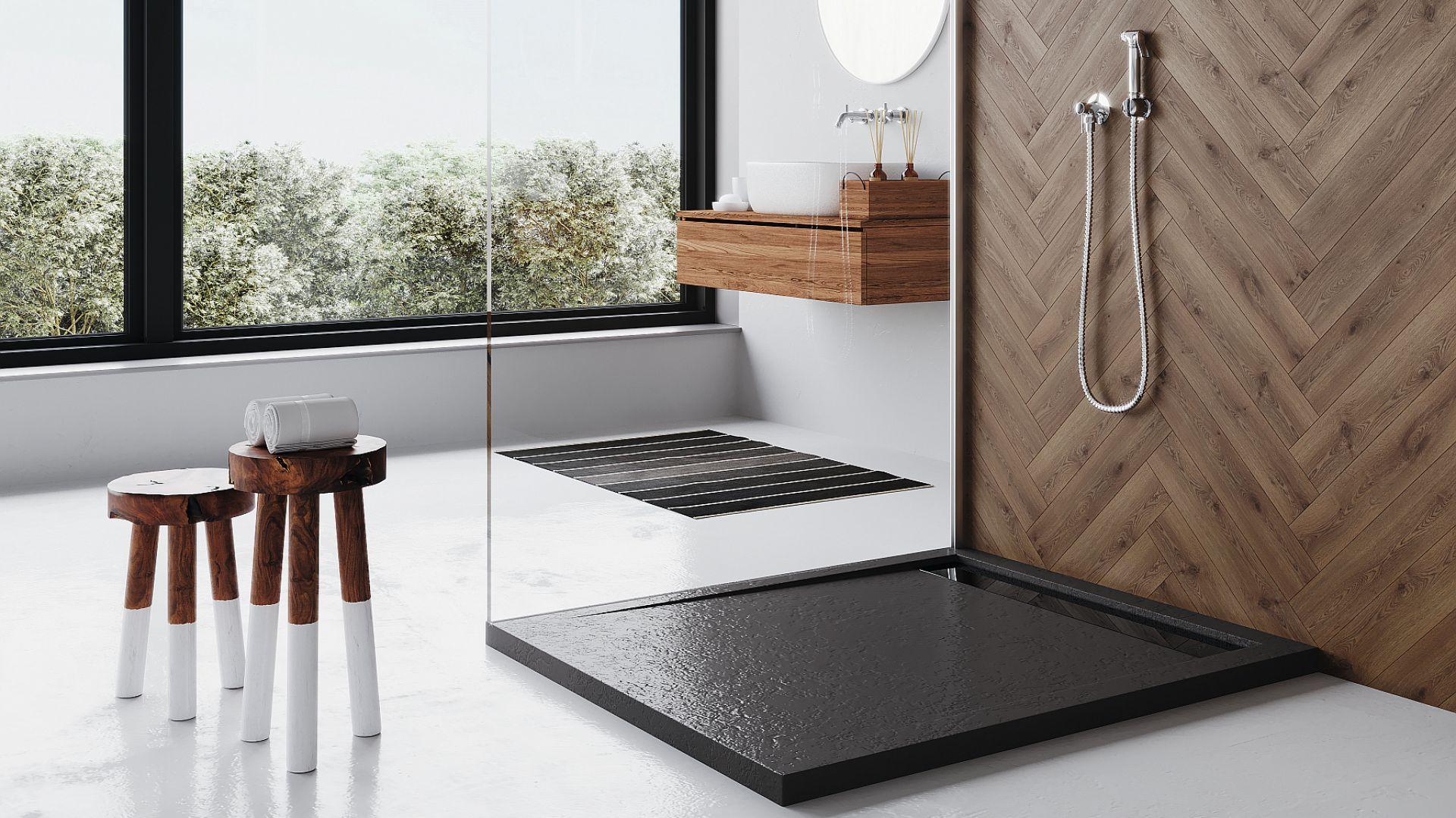 WEST NEW  - brodzik wykonany z wysokiej jakości akrylu sanitarnego posiada 10-letnią gwarancję producenta. Dostępne wymiary: 110x90 cm, 120x100 cm, kolory: biały, czarny oraz biały i czarny w strukturze kamienia. Fot. Polimat