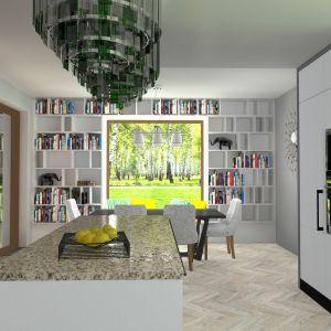 Jadalnia jest połączona z kuchnią, salon jest nieco na uboczu. Dom TK177. Projekt: arch. Tomasz Kałaska. Fot. Architeka Pracownia Architektoniczna