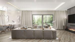 Wnętrze domu zaskakuje minimalizmem i elegancją. Po wejściu uwagę przykuwa otwarta strefa dzienna z jadalnią i osiowo zlokalizowanym kominkiem. Projekt i wizualizacje: 3DPROJEKT architektura