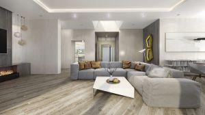 Na uwagę zasługuje również podłoga. Użycie tej samej deski w całym domy dało spektakularny efekt. Zdecydowano się na kontynuację wzoru we wszystkich pomieszczeniach, co biorąc pod uwagę, że poszczególne skrzydła domu usytuowane są do siebie nierównoległe daje efekt skośnej podłogi w salonie, kierunek ten kontynuowany jest w ułożeniu deski na tarasie. Projekt i wizualizacje: 3DPROJEKT architektura