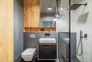 Łazienka również nawiązuje stylistyką do pozostałych pomieszczeń. Projekt i zdjęcia: Deer Design