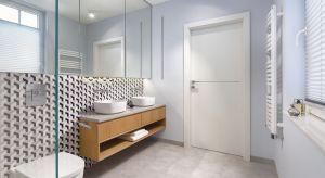 Nowoczesne wyposażenie o oszczędnych formach, dobrane z naciskiem na funkcjonalność poszczególnych rozwiązań zestawione zostało z wyrazistymi fakturami materiałów wykończeniowych. Tak urządzona łazienka jest jednocześnie elegancka, ale i bar
